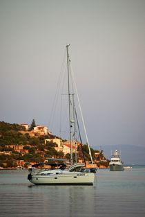 A boat in the bay von photogatar