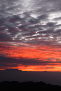 Sunrise over the Himalayas. by Tom Hanslien