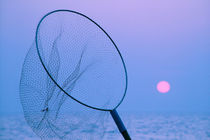 Fish catcher net against sunset in Thailand by ingojez