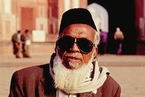 Old Muslim man at the Taj Mahal, India by ingojez