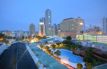 Panama city, Panama close cityscape Top view with blue pool sorrounded by buildings in the sunrise by David Castillo Dominici
