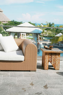 Backyard with modern sofa and end table by David Castillo Dominici