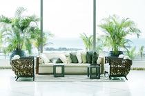 sofas overlooking sea by David Castillo Dominici
