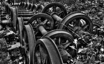 Rusting wheels of steel  by Rob Hawkins