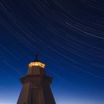 Startrails over lighthouse by Mikael Svensson