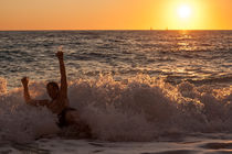 Play with the wave at sunset by Chris Christidis