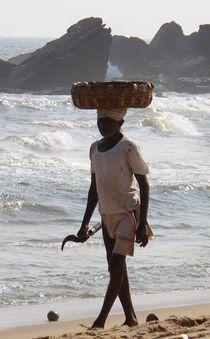 Kokosnussverkäufer am Strand von reisemonster