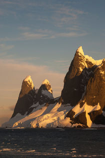 ANTARCTICA, ANTARCTIC PENINSULA, LEMAIRE CHANNEL, MOUNTAINS AND GLACIERS IN EVENING LIGHT by Wolfgang Kaehler