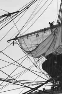 Sailor shortening sails on a tall ship - monochrome by Intensivelight Panorama-Edition