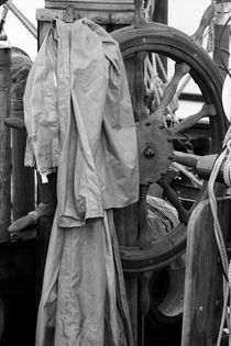 Raincoat on ship's wheel by Intensivelight Panorama-Edition