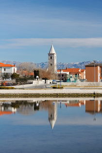 Church tower sea reflection.  by Gordan Bakovic
