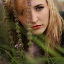 Young girl among flowers. by Ekaterina Planina