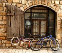 Old bikes in old street by margarita