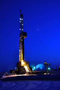 Drilling Rig at Night by evgeny bashta