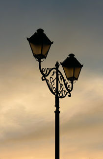 Lantern on the background sky  by Volodymyr Chaban