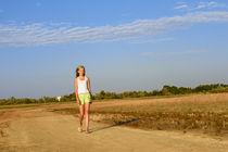 Teenage girl on the sandy road by Volodymyr Chaban