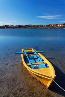 Yellow fishing boat anchored in calm mediterranean bay. by Gordan Bakovic