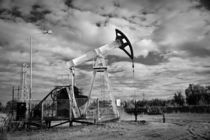 Pump jack and oilwell. by evgeny bashta