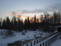 Sunset by the River at Winter Time by Katri Ketola