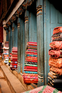 Textile shops in Bhaktapur, Nepal. by Tom Hanslien