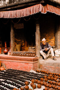 A vendor in Bhaktapur Pottery Square. by Tom Hanslien