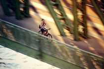 Cyclist cross a bridge by marunga