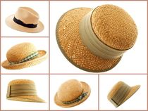 Straw hats assorted isolated on white by 7horses