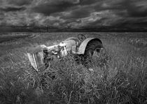 Abandoned Farm Tractor on the Prairie Black and White Version by Randall Nyhof