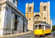 Historic yellow tram of Lisbon, Portugal by Michael Abid