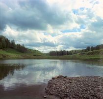 Stony coast, wood lake and sky with clouds by Roman Popov