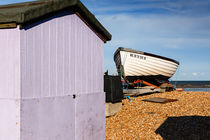 A beach hut and a boat at Greatstone Beach. by Tom Hanslien