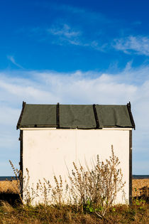 White beach hut at Greatstone Beach. by Tom Hanslien