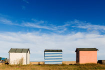 Three huts on the beach. by Tom Hanslien