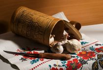 Still life with garlic, a knife, a towel and tuesok. by Roman Popov