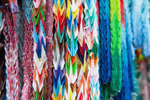 Close up of colorful origami offerings by holka