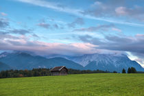 Sunset over alpine meadow by Olha Rohulya