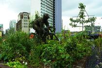 Grüner Radfahrer, Green bicyclist in Manchester von Sabine Radtke