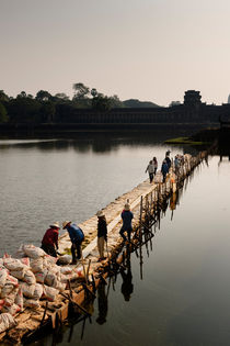 Maintenance at Angkor Wat. by Tom Hanslien