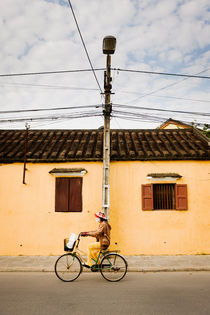A passing cyclist, Hoi An. by Tom Hanslien