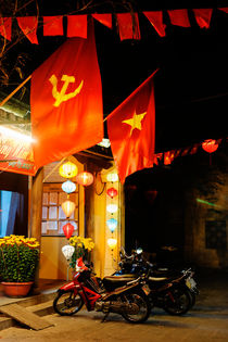 Communist flags in Hoi An. by Tom Hanslien