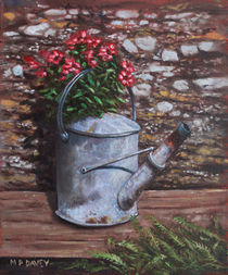 Old watering can with flowers by stone wall von Martin  Davey