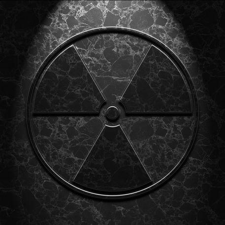 Radioactive-symbol-black-marble-texture-old