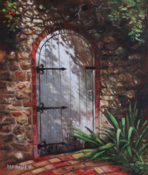 Decorative door in archway set in stone wall surrounded by plants by Martin  Davey