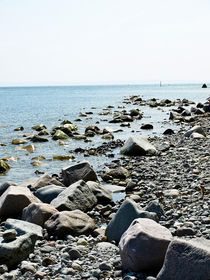 A stony beach of the Island of Rügen by madle-fotowelt