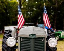 Vintage Ferguson Tractor With American Flags von Jon Woodhams
