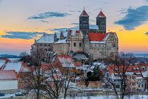 Schloss Quedlinburg und Stiftskirche im winterlichen Sonnenuntergang von Daniel Kühne