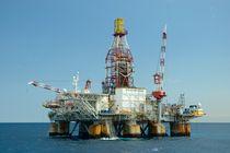 Ocean oil rig by Bradford Martin