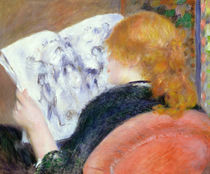 Young Woman Reading an Illustrated Journal by Pierre-Auguste Renoir