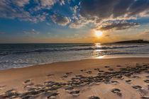 Cloudy sunset over a deserted beach by Nikos Vlasiadis