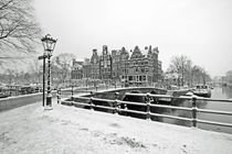 Old dutch winter scenery in Amsterdam the Netherlands  by nilaya
